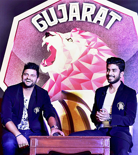 Suresh Raina newly appointed captain of the Gujarat Lions, with team owner Keshav Bansal during the unveiling of the the team logo in New Delhi on Tuesday