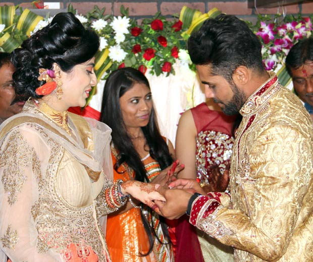 Riva Solanki and Ravindra Jadeja  exchange rings at the engagement