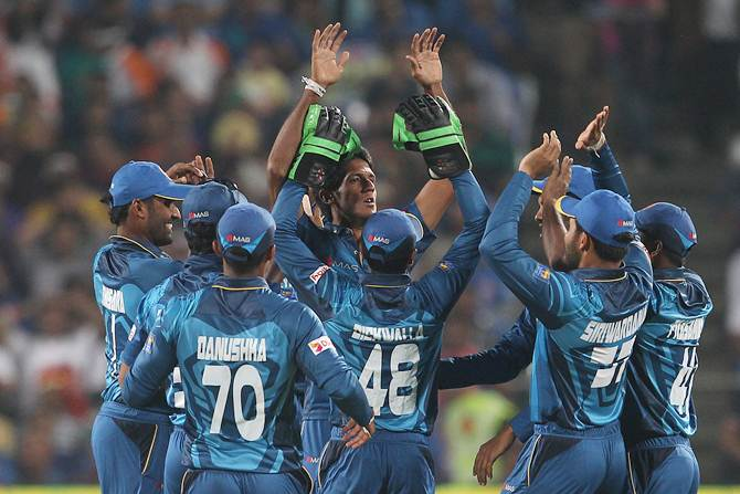 Sri Lanka pacer Kasun Rajitha celebrates after dismissing Rohit Sharma in the first T20 against India in Pune on Tuesday.