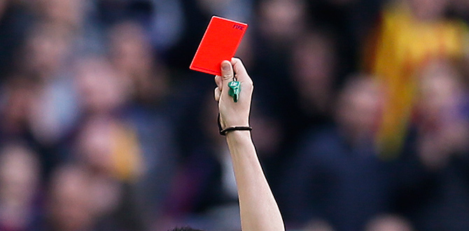 A referee flashing a red card