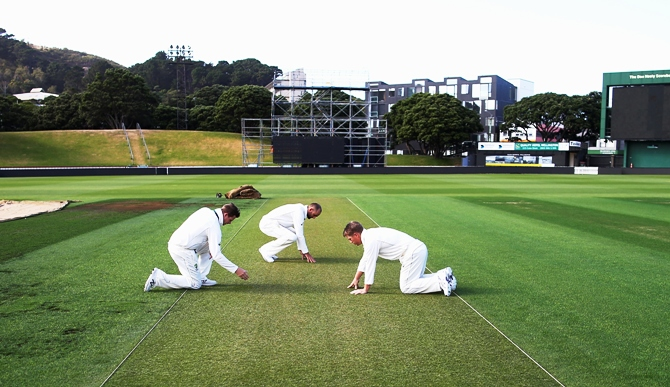 Steve Smith, Nathan Lyon and David Warner of Australia inspect the wicket