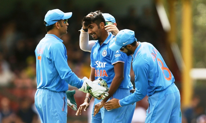 India captain MS Dhoni congratulates Jasprit Bumrah for taking a wicket