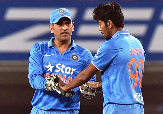 India's captain MS Dhoni celebrates with Jasprit Bumrah during the second T20I against Sri Lanka in Ranchi