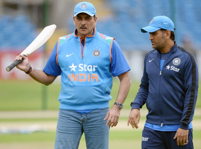 Indian Team Director Ravi Shastri (left) with captain Mahendra Singh Dhoni