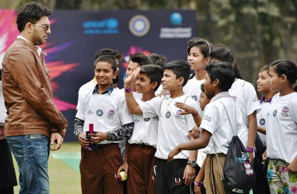 Yuvraj Singh interacts with the children