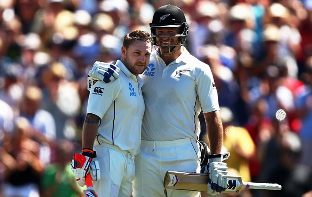 Brendon McCullum of New Zealand is congratulated by Corey Anderson