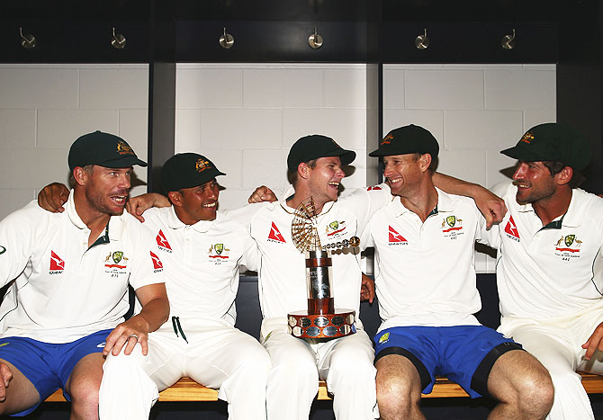 Australia's David Warner, Usman Khawaja, captain Steve Smith, Adam Voges and Joe Burns celebrate with the Trans-Tasman Trophy in the change rooms after winning the Test match against New Zealand at Hagley Oval in Christchurch on Wednesday