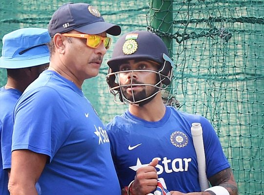 India team director Ravi Shastri with Virat Kohli during a practice session