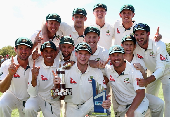 The Australian team celebrate with Trans Tasman Trophy