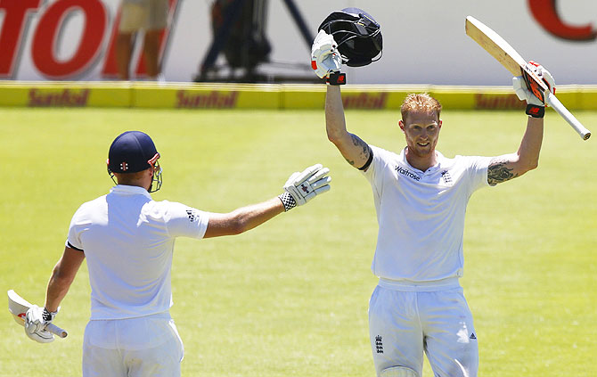 England's Ben Stokes celebrates scoring a double century with Jonny Bairstow during the second cricket Test match against South Africa in Cape Town on Sunday