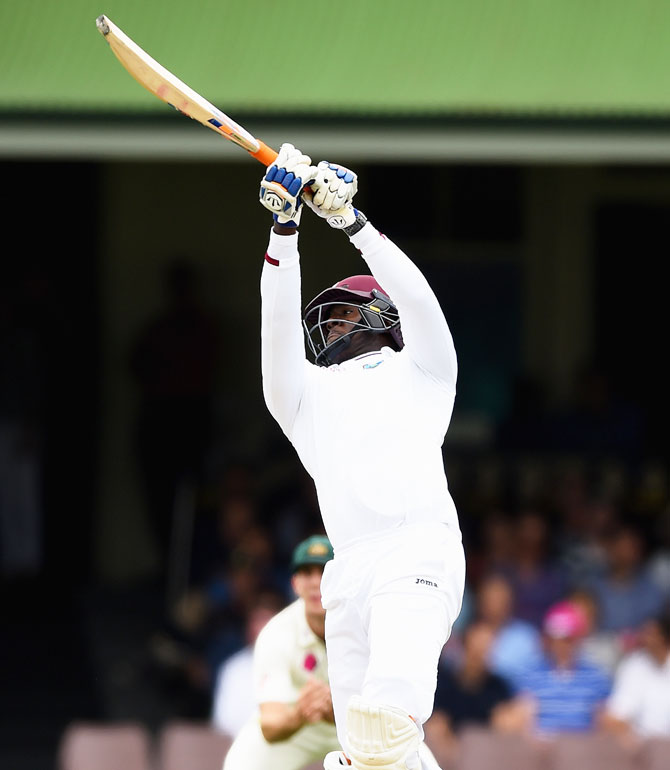 West Indies' Carlos Brathwaite heaves a delivery for a six