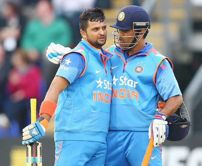 Suresh Raina (left) and Mahendra Singh Dhoni