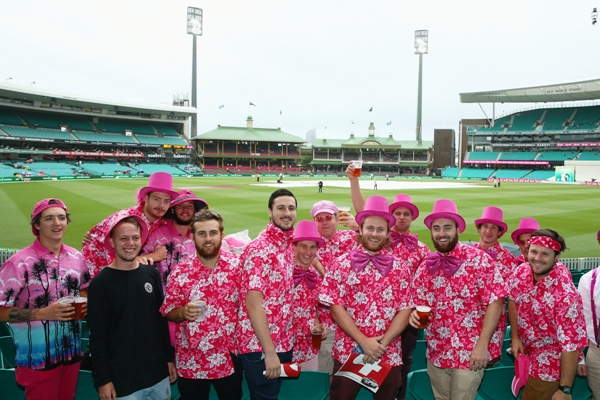 Members of the crowd dressed in pink for Jane McGrath Day pose