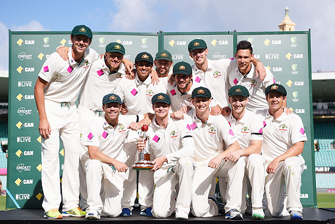 The Australian team pose with the Frank Worrell Trophy after winning the series against West Indies on Day 5 of the third Test match at Sydney Cricket Ground in Sydney on Thursday