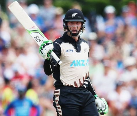 Martin Guptill of the Black Caps acknowledges the crowd after scoring fifty