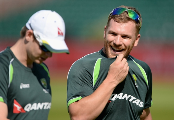 Aaron Finch of Australia chats with captain Steven Smith during a nets session
