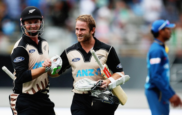 Colin Munro of New Zealand celebrates with captain Kane Williamson