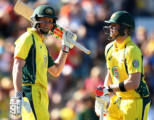 George Bailey of Australia celebrates his half century with Steven Smith during the the first ODI against India in Perth