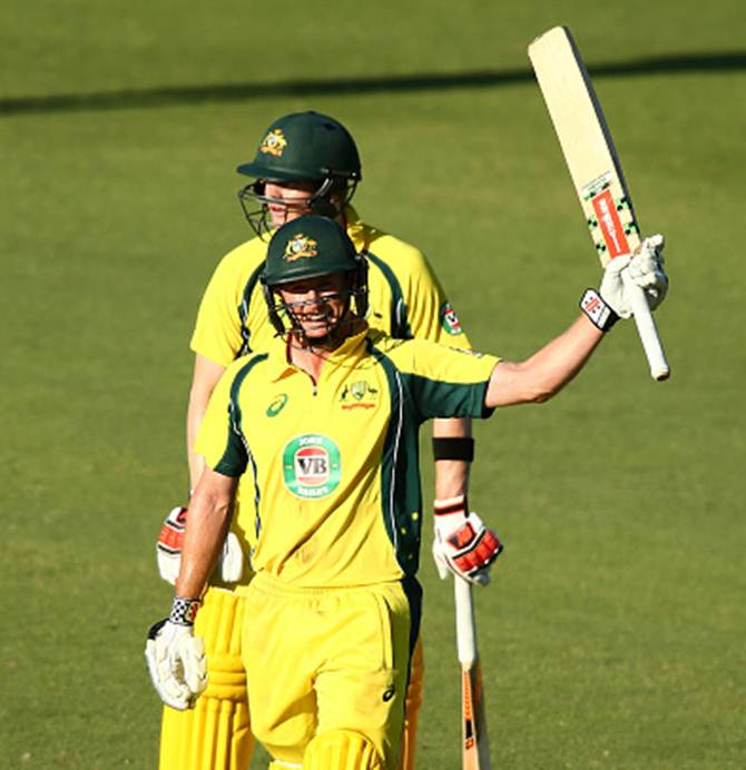 Australia's George Bailey celebrates after getting to hundred as his skipper, Steven Smith, watches in the first ODI against India in Perth on Tuesday.