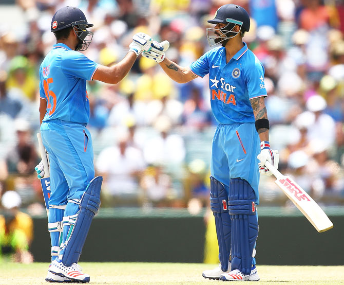 India's Rohit Sharma congratulates teammate Virat Kohli after reaching his half-century during the first One-Day International against Australia at the WACA in Perth on Tuesday