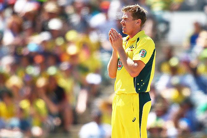 James Faulkner of Australia looks on