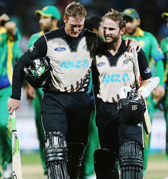 Martin Guptill of the Black Caps celebrates with Kane Williamson