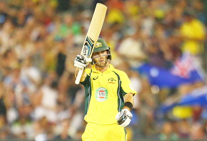 Glenn Maxwell of Australia celebrates as he reaches his fifty during the 3rd One-Dayer in Melbourne on Sunday