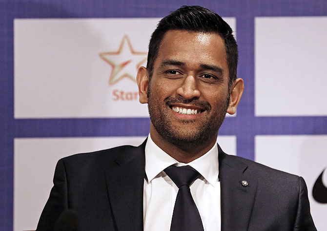India's cricket captain Mahendra Singh Dhoni smiles during a news conference