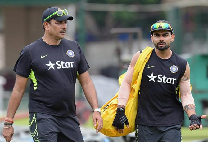 India's Test captain Virat Kohli (right) with Technical director Ravi Shastri