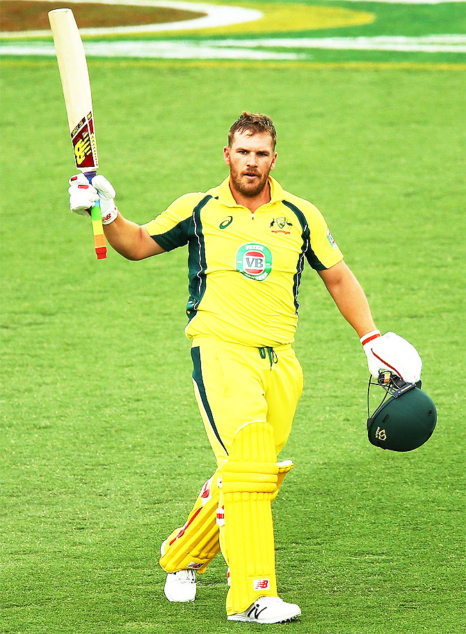Australia opener Aaron Finch celebrates after scoring a century.