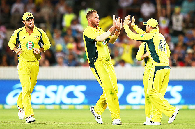 Australia's John Hastings (centre) celebrates a wicket