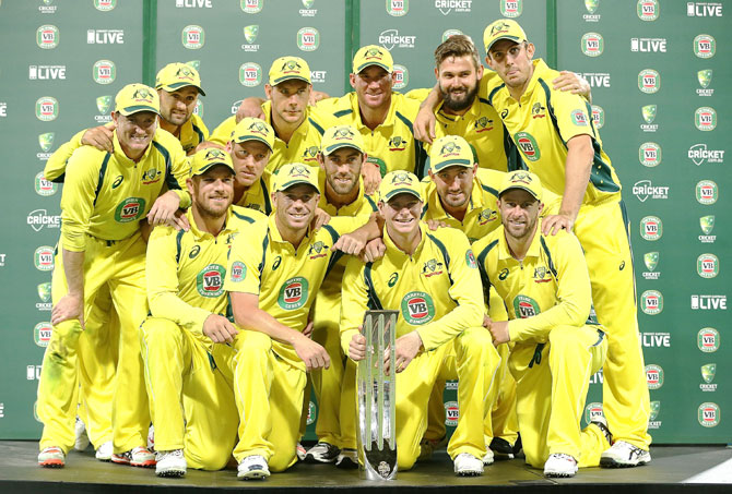 The Australian team pose with the winners' trophy after winning the five-match Commonwealth Bank One Day Series 4-1 at Sydney Cricket Ground on Saturday