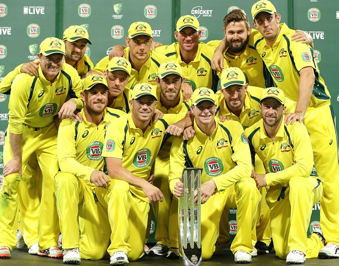 The Australian team pose with the winners trophy after winning the series