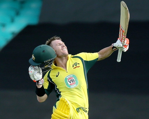 David Warner of Australia celebrates and acknowledges the crowd after scoring a century