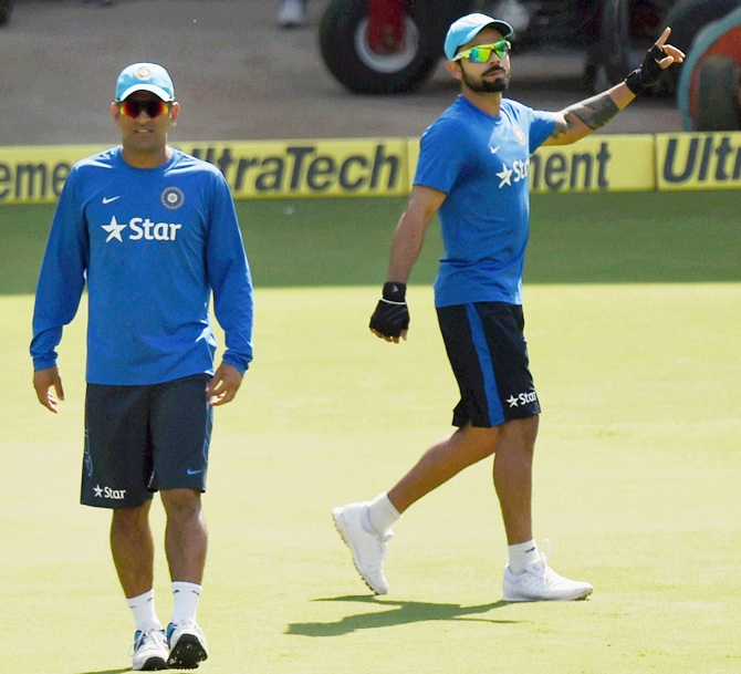 Indian captain MS Dhoni and Virat Kohli during practice session