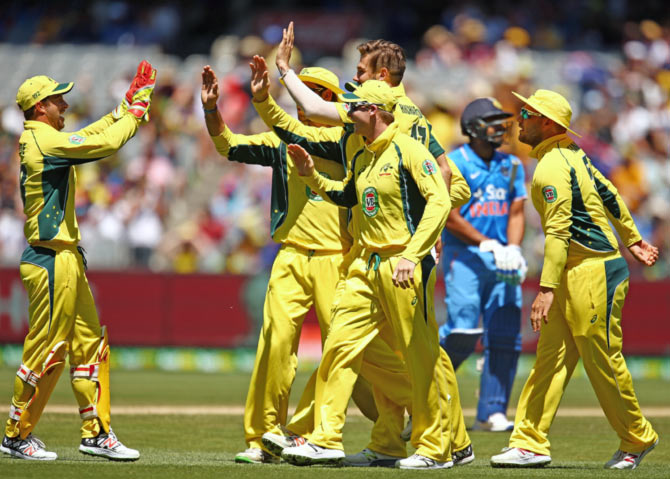 Australian players celebrate the fall of an Indian wicket during the recent ODI series