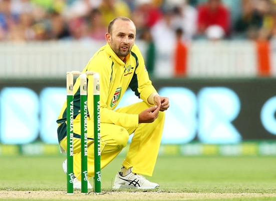 Nathan Lyon of Australia reacts after a delivery