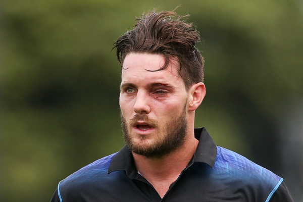Mitchell McClenaghan of New Zealand leaves the field with an injured eye