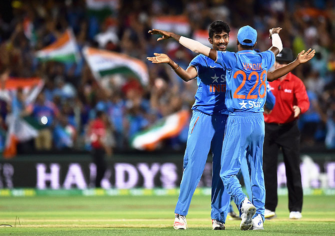 Jasprit Bumrah celebrates with Hardik Pandya after the wicket of Cameron Boyce