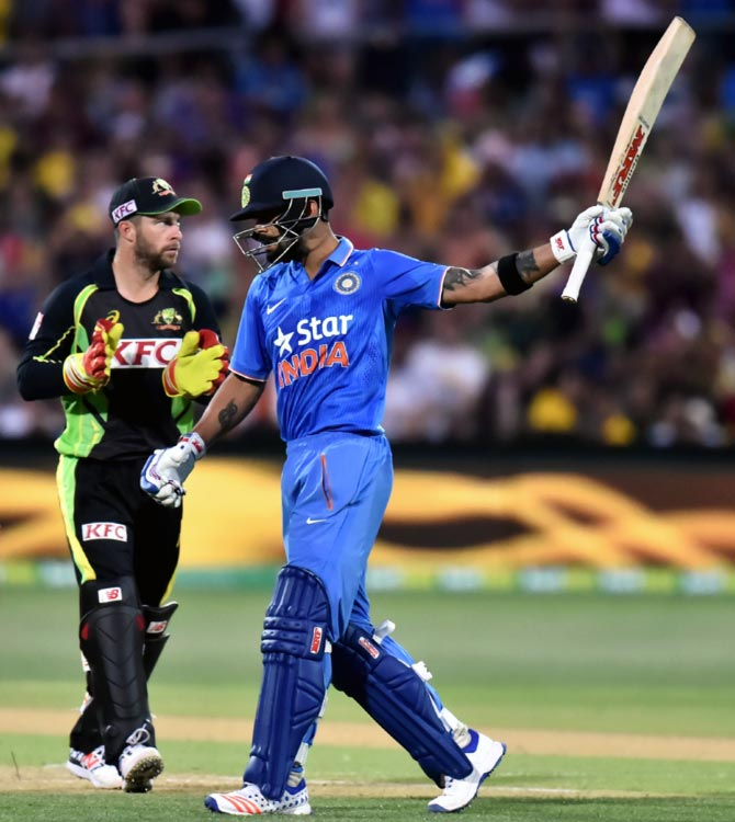 India's Virat Kohli reacts after reaching his half century during the first Twenty20 International match against Australia at Adelaide Oval on Tuesday