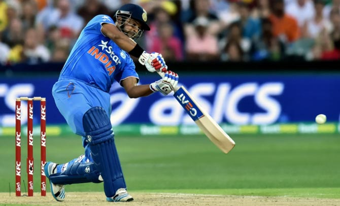 Suresh Raina hits a boundary through the off-side