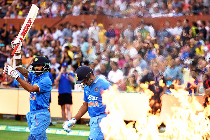 Rohit Sharma and Shikhar Dhawan walk out onto the field to bat in the 1st Twenty20 International match against Australia at Adelaide Oval on Tuesday