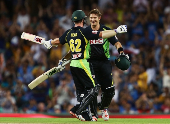 Shane Watson of Australia (right) celebrates with teammate Travis Head after scoring a century