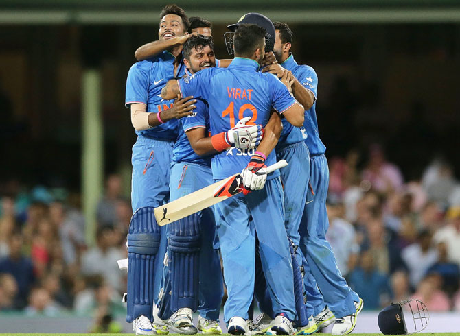 India players celebrate victory over Australia in the third Twenty20 international match at Sydney Cricket Ground on Sunday