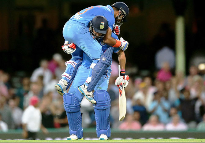 India's Suresh Raina and Yuvraj Singh are ecstatic after their win in the third T20 in Sydney on Sunday