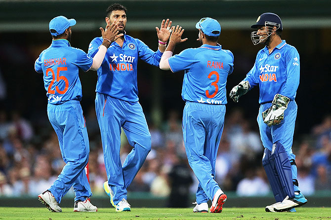 Yuvraj Singh celebrates with teammates after claiming a wicket