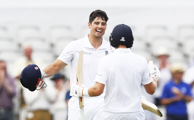 England's Alastair Cook celebrates his century with Joe Root in Day 1 on the 2nd Test on Friday