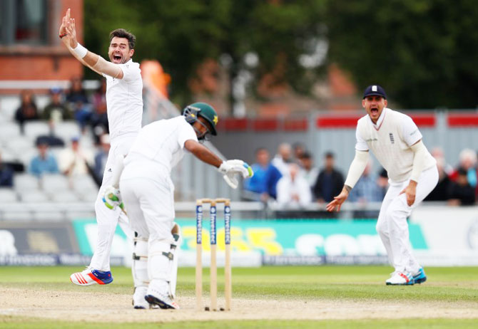 England's James Anderson celebrates taking the wicket of Pakistan's Asad Shafiq on Day 4 of the 2nd Test at Old Trafford in Manchester on Monday