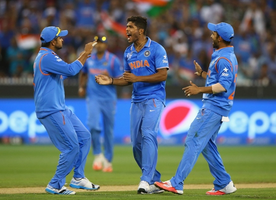 Umesh Yadav of India celebrates after taking a wicket