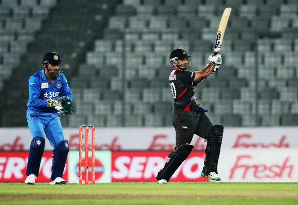 United Arab Emirates' batsman Shaiman Anwar plays a shot during the Asia Cup